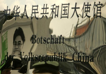 A picture of jailed Chinese journalist Shi Tao is reflected in the entrance sign of China's embassy in Berlin August 24, 2007. REUTERS/Tobia