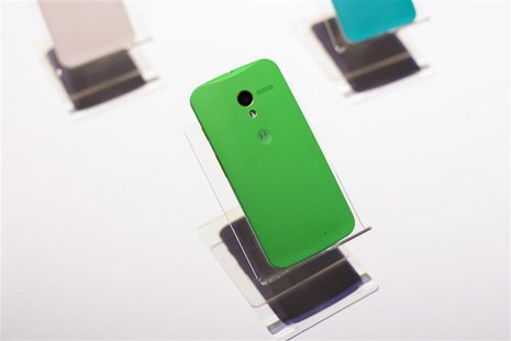 Different colored examples of Motorola's new Moto X phones rest on a table at a launch event in New York, in this August 1, 2013, file photo