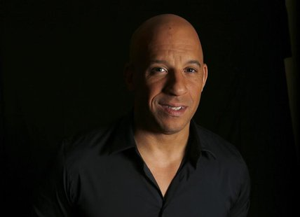 "Actor Vin Diesel poses for a portrait while promoting his upcoming movie ""Riddick"" in Los Angeles, California August 27, 2013. REUTERS/Mario"