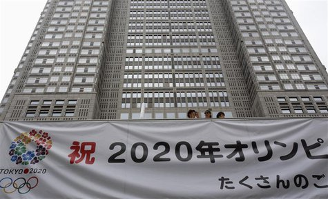 "A huge banner reading ""Celebration 2020 Olympics"" is set up at Tokyo Metropolitan Government Building in Tokyo September 8, 2013. REUTERS/Yu"