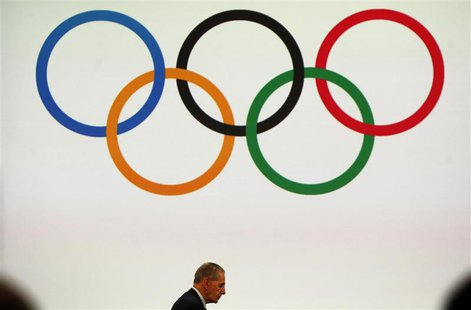 President of the International Olympic Committee (IOC) Jacques Rogge (L) attends the board session in Buenos Aires September 8, 2013. REUTER