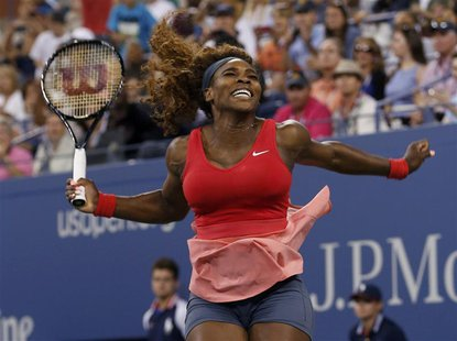Serena Williams of the U.S. celebrates after defeating Victoria Azarenka of Belarus in their women's singles final match at the U.S. Open te