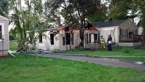 House in the 1400 block of Bismark Street in Allouez damaged by fire early Sunday. (Photo by: FOX 11).