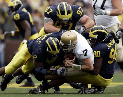 QB Jimmy Clausen gets sacked during the epic 2007 battle between the Fighting Irish and the Wolverines. (Photo : Reuters)