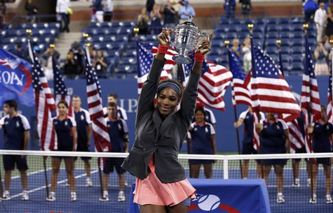 Serena Williams of the U.S. raises her trophy after defeating Victoria Azarenka of Belarus in their women's singles final match at the U.S.