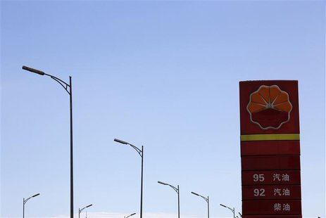 The PetroChina company logo is seen next to street lamps at its gas station in Beijing August 29, 2013. REUTERS/Kim Kyung-Hoon