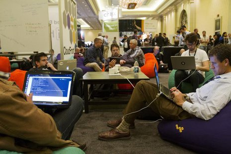 Developers and programmers participate in a coding challenge at the AWS Re:Invent conference at the Sands Expo in Las Vegas Nevada Nov. 28,