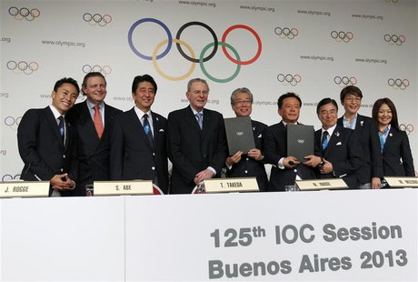 Japan's Prime Minister Shinzo Abe (3rd L) stands with Jacques Rogge (4th L), president of the International Olympic Committee (IOC), Governo