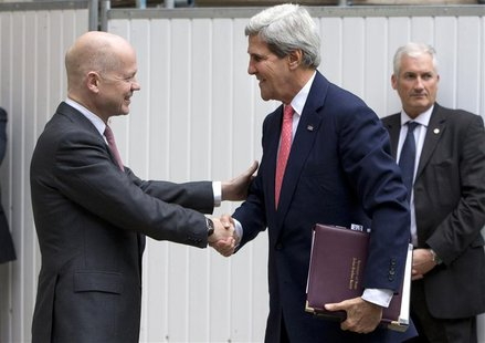 Britain's Foreign Secretary William Hague (L) greets U.S. Secretary of State John Kerry outside the Foreign Office in London September 9, 20