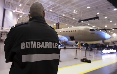 A security guard looks on as Bombardier unveiled its CSeries aircraft at a news conference at its assembly facility in Mirabel, Quebec, Marc