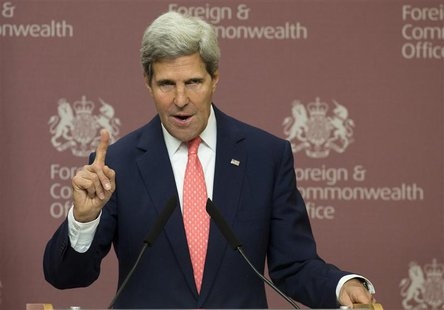 U.S. Secretary of State John Kerry gestures during his joint news conference with Britain's Foreign Secretary William Hague at the Foreign a
