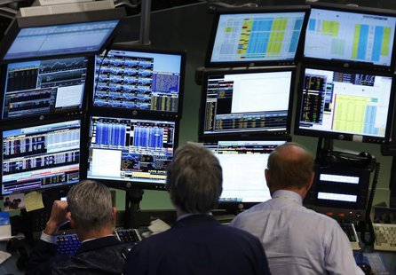 Traders work at Bloomberg terminals on the floor of the New York Stock Exchange, May 13, 2013. REUTERS/Brendan McDermid