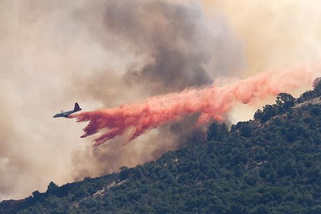 A plane drops fire retardant on the Morgan fire burning atop Mount Diablo as seen from Clayton, California September 9, 2013. REUTERS/Noah B