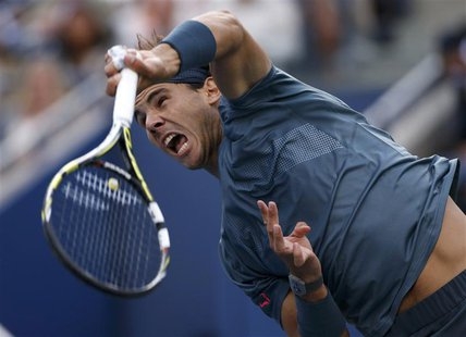 Rafael Nadal of Spain serves to Novak Djokovic of Serbia in their men's final match at the U.S. Open tennis championships in New York, Septe
