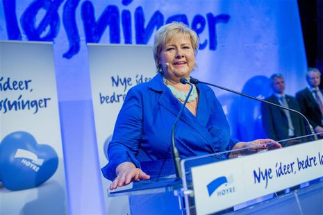 Norway's main opposition leader Erna Solberg of Hoyre speaks to party members while waiting for the results of the general elections in Oslo