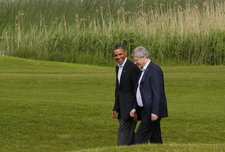 U.S. President Barack Obama walks with Canadian Prime Minister Stephen Harper during the G8 summit at Lough Erne Resort in Enniskillen, Nort