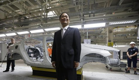 Chairman of Zhejiang Geely Holding Group Li Shufu poses for a photo at an assembly line of the new Volvo automobile manufacturing plant in C