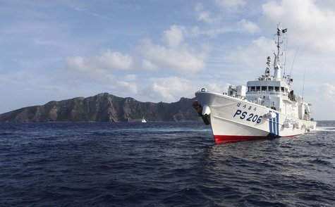 Japan Coast Guard vessel PS206 Houou sails in front of Uotsuri island, one of the disputed islands, called Senkaku in Japan and Diaoyu in Ch