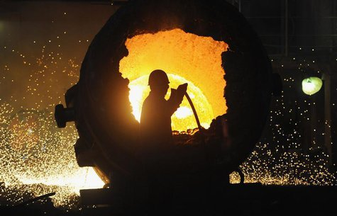 A worker operates a furnace at a steel plant in Hefei, Anhui province August 18, 2013. REUTERS/Stringer