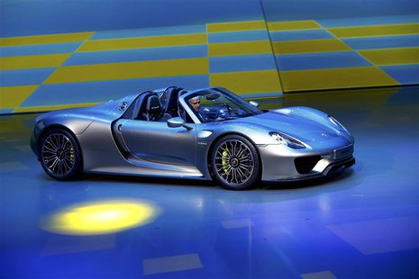 Porsche CEO, Matthias Mueller presents the new Porsche 918 Spyder hybrid car at the Volkswagen group night at the Frankfurt motor show Septe