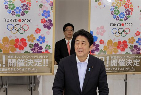 Japan's Prime Minister Shinzo Abe smiles as he reports to his cabinet members Tokyo's successful bid to host the 2020 Summer Olympics and Pa