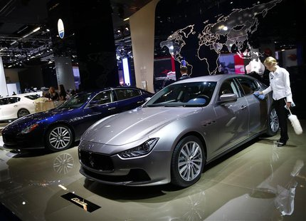 A Maserati Ghibli car is polished by a worker during a media preview day at the Frankfurt Motor Show (IAA) September 10, 2013. REUTERS/Kai P