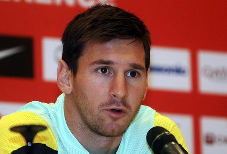 Barcelona's Lionel Messi speaks during a news conference ahead of the team's friendly soccer match against Malaysia XI on Saturday, in Petal