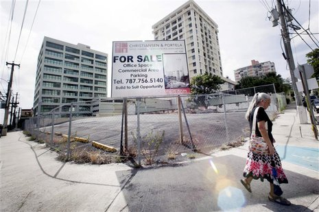 A billboard announces office space and parking for sale in San Juan, August 31, 2013. REUTERS/Alvin Baez