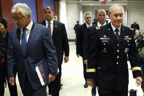 U.S. Defense Secretary Chuck Hagel (L) and Chairman of the Joint Chiefs of Staff U.S. Army General Martin Dempsey (R) arrive to brief member