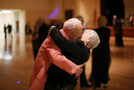 Donald Smitherman, 98, kisses his wife Marlene at the end of a dance in Sun City, Arizona, January 5, 2013. REUTERS/Lucy Nicholson