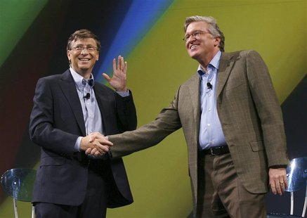 Microsoft Chairman Bill Gates (L) and Microsoft Business Division President Jeff Raikes shake hands after the launch of Unified Communicatio