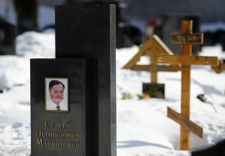 A picture of lawyer Sergei Magnitsky is seen on his grave in the Preobrazhensky cemetery in Moscow March 11, 2013. REUTERS/Mikhail Voskresen