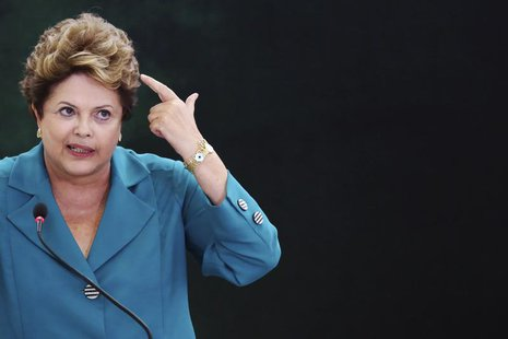 Brazil's President Dilma Rousseff speaks during a ceremony where she signs into law, the bill that allocates the country's oil royalties to