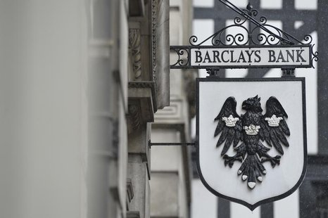 A logo hangs outside a branch of Barclays bank in London July 30, 2013. Barclays is raising 5.8 billion pounds ($8.9 billion) from its share