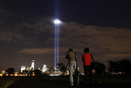 The annual Tribute in Light is tested in New York's Lower Manhattan as a man takes a picture at Liberty State Park in Jersey City, New Jerse