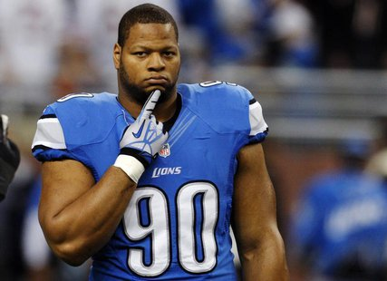 Detroit Lions defensive tackle Ndamukong Suh stands on the field during warms-ups of their NFL football game against the Chicago Bears in De