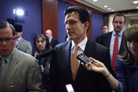 U.S. House Majority Leader Eric Cantor (R-VA) (C) arrives for a briefing to all members of Congress by senior Obama administration officials
