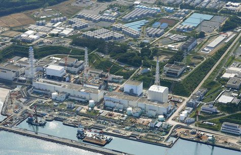 An aerial view shows the Tokyo Electric Power Co.'s (TEPCO) tsunami-crippled Fukushima Daiichi nuclear power plant and its contaminated wate