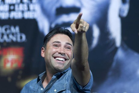 Oscar De La Hoya points towards the crowd before an official weigh-in for WBC welterweight champion Floyd Mayweather Jr. and Robert Guerrero