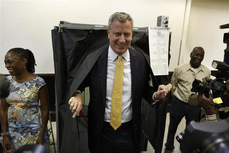 New York City democratic mayoral candidate Bill de Blasio exits a voting booth in the Brooklyn borough of New York after voting in the democ