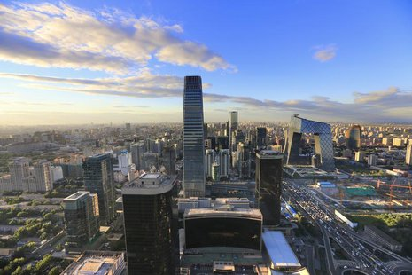 A view of the city's skyline from the Beijing Yintai Centre building at sunset is seen in Beijing, August 29, 2013. REUTERS/Jason Lee