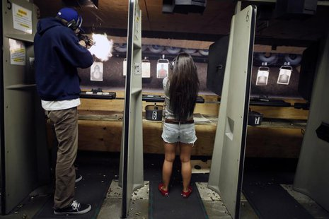 People fire at targets at the Los Angeles gun club in Los Angeles, January 23, 2013. REUTERS/Lucy Nicholson