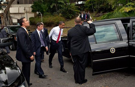 President Obama prepares to enter the presidential limo on his way to Piarco International Airport on April 19th, 2009.