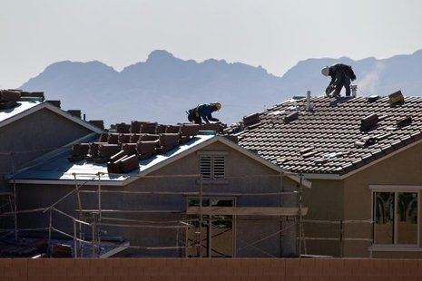 Roofers work on new homes at a residential construction site in the west side of the Las Vegas Valley in Las Vegas, Nevada April 5, 2013. RE