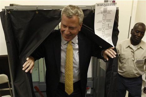New York City Democratic mayoral candidate Bill de Blasio exits a voting booth after voting in the Democratic primary election in the Brookl