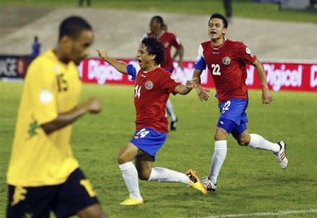 Costa Rica's Randall Brenes (C) celebrates his goal with teammate Jose Miguel Cubero (R) as Jamaica's Shaun Cummings returns to position dur