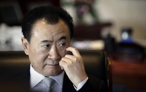 Wang Jianlin, chairman of Dalian Wanda Group, touches his face during an interview at his office in the company's headquarters in Beijing De