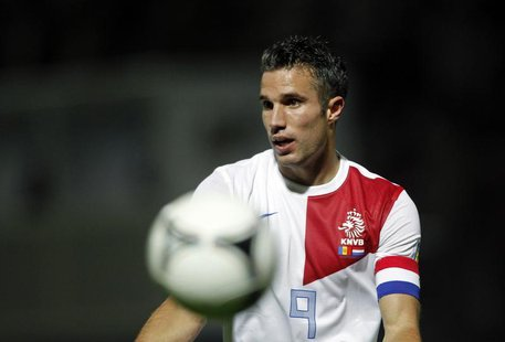 Netherlands's player Robin van Persie gestures during their World Cup qualifying round soccer match against Andorra at Estadi Comunal in And