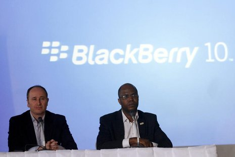 BlackBerry's Senior Director for Product Management Roger Enright (L) sits with Uzo Eziukwu, CEO of Parkway Projects which is partnering wit