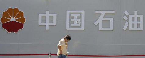 A man walks past a PetroChina company logo at its gas station in Beijing August 29, 2013. REUTERS/Kim Kyung-Hoon